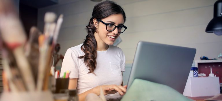 woman working on a laptop starting a business